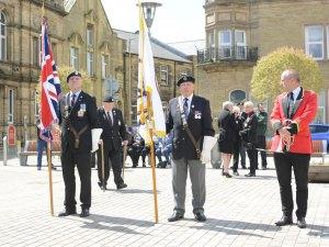 Flag bearers plus bugler